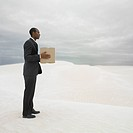 Businessman in the desert with a package, Lancelin, Australia