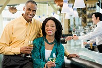 African American couple smiling at bar