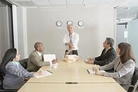 Senior Asian businessman presiding over a meeting