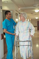 African female doctor helping patient with walker, Bethesda, Maryland, United States