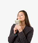 Studio shot of businesswoman holding money