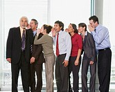 Group of businesspeople whispering in each other´s ears