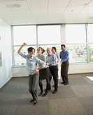 Businesspeople in a conga line at the office, Redwood City, California, United States