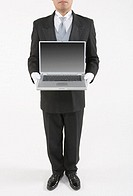 Butler holding a laptop