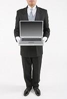 Butler holding a laptop