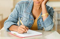 Female teenager writing in her notebook