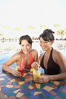 Two Hispanic women at hotel pool bar, Los Cabos, Mexico (thumbnail)