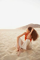 Hispanic woman on the beach, Los Cabos, Mexico