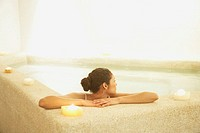 Woman relaxing in spa room
