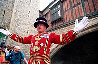 England, London, Tower of London, Beefeater in State Dress giving Guided Tour to Tourists