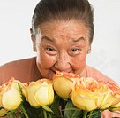 Woman Smelling Bouquet of Fresh Roses
