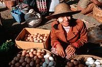 Burmese Womanan selling Eggs on a market