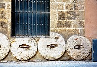 Old millstones. Santa Cruz quarter, Sevilla. Andalusia, Spain