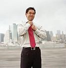 UsA, New York, New York City, businessman knotting tie