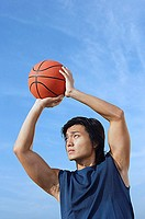 Man aiming basketball