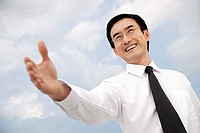 Businessman with hand outstretched