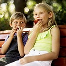 boy and a girl (8-11) eating apples
