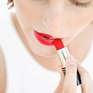 close-up of a woman applying lipstick