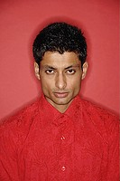 Man looking at camera, wearing red shirt