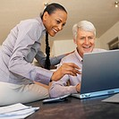 a couple working together on a laptop