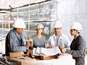 architects talking to a construction worker at a construction site