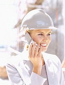 close-up of a female architect talking on a mobile phone at a construction site