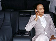 businesswoman talking on a mobile phone in a car