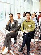 portrait of business executives at a seminar