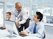 two business executives discussing in front of a computer