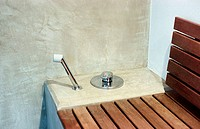 Shower, hand shower and a wooden bench in a spa (thumbnail)