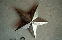 A silver decoration star at a window