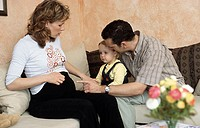 A young couple, young man and young pregnant woman, 25-30 30-35 35-40 years old (thumbnail)