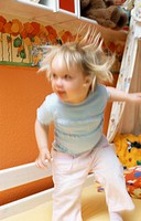 A little girl, 1-5 years old, playing in the nursery