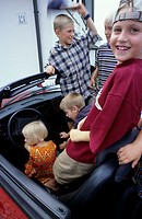 Five children, four boys, a little girl, 1-5 5-10 years old, sitting in a car, cabriolet (thumbnail)