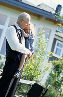 A senior, businessman, father, grandfather, 45-50 50-55 55-60 years old, holding a little girl (thumbnail)