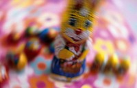 A chocolate Easter bunny on a coloured ground, blurred