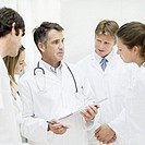 a team of doctors and nurses having a meeting