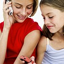two girls (8-12) using mobile phones