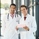 Portrait of two young male medical professionals