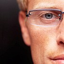 Close-up of a young businessman wearing glasses