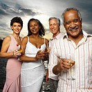 Portrait of two elderly couples holding wine glasses smiling