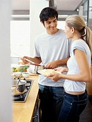 young couple standing in the kitchen