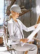 female architect looking at a blueprint