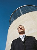 low angle view of a businessman standing in front of a structure