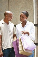 close-up of a young couple holding shopping bags