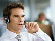 close-up of a businessman wearing a headset in an office
