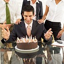 business executives celebrating a male executives birthday