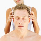 Man getting a head massage from a woman