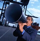 close-up of a businessman speaking through a loudspeaker