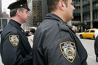 Policemen, police, law officers, cops. 6th Avenue of the Americas. Manhattan. New York. USA.